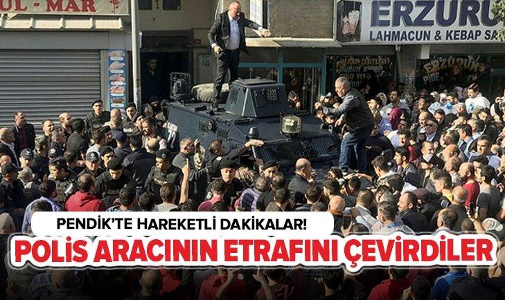 ÖFKELİ KALABALIK POLİS ARACININ ETRAFINI ÇEVİRDİ