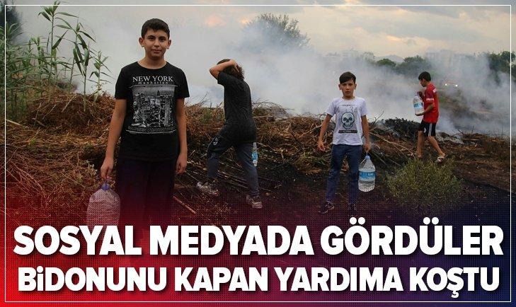 ANTALYA'DA SOSYAL MEDYADAN GÖRDÜKLERİ YANGINA BİDONLARLA KOŞTULAR