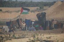 İşgalci İsrail askerleri Gazze sınırında yüzlerce Filistinliyi yaraladı