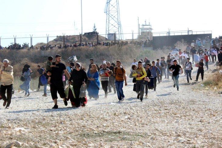 Suriyeliler koşa koşa ülkelerine gidiyor