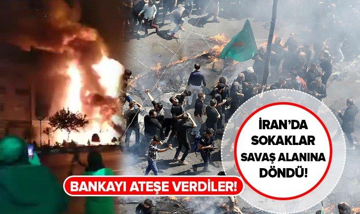 İRAN'DA BENZİN ZAMMI PROTESTOLARI SÜRÜYOR! BANKA ŞUBESİNİ ATEŞE VERDİLER!
