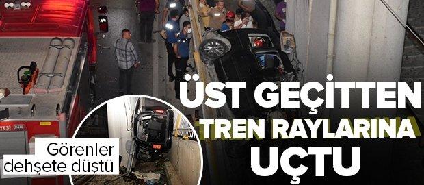 İzmir'de hafif ticari araç üst geçitten tren raylarına uçtu: Ölü ve yaralılar var